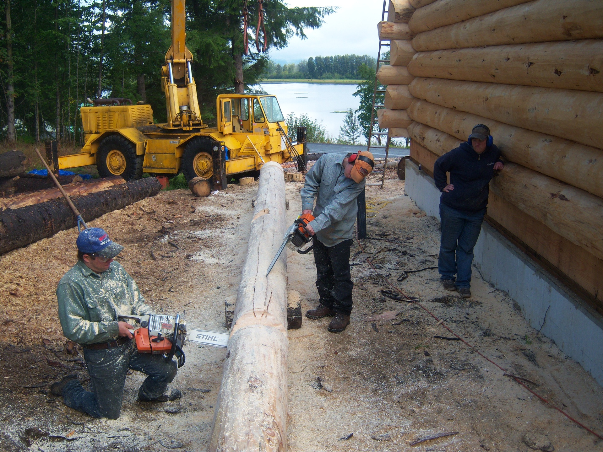 Cutting v-groove and notching logs.